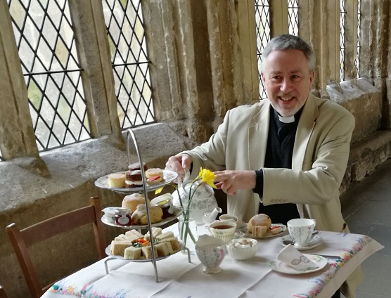 The Dean of Wells enjoys afternoon tea in the cloister at Wells Cathedral